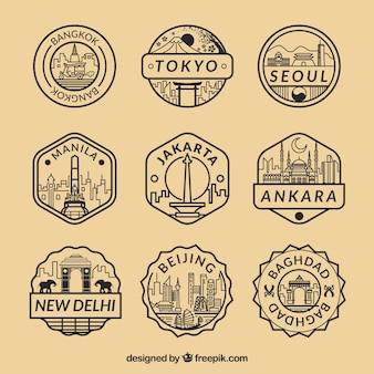 Coleção plana de selos fantásticos com diferentes cidades