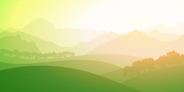 Colinas verdes e picos de montanhas ao nascer do sol