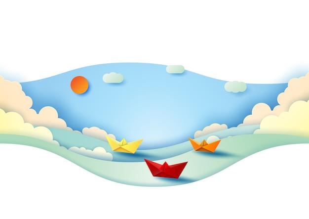 Colora os barcos de papel que navegam no mar com fundo do céu azul.
