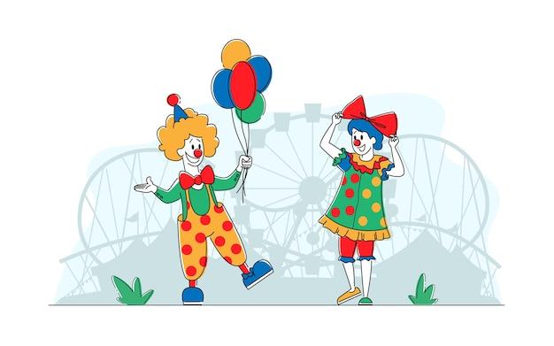 Comediantes palhaços no parque de diversões