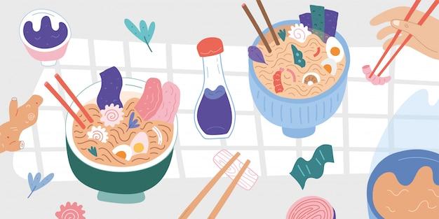 Comida asiática na mesa, tigelas de macarrão ramen e pauzinhos