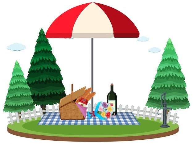 Comida na cesta e garrafa de vinho para piquenique