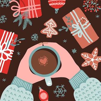 Composição aconchegante de natal e ano novo com mãos humanas no suéter segurando uma caneca de café