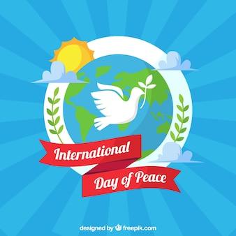 Composição colorida da paz com pomba, mundo e fita
