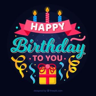 Composição de aniversário com presente e velas