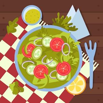 Composição de comida vegana com vista superior do prato servido com vegetais, fatias de tomate e salada