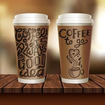 Composição de duas xícaras de café para viagem