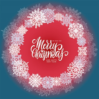 Composição do círculo com flocos de neve e mão escrito texto feliz natal.