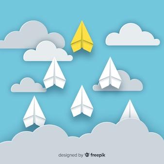 Composição original de liderança com aviões de papel