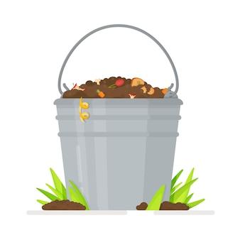 Compostores de jardim para resíduos biodegradáveis. balde cheio de solo fértil com vermes.