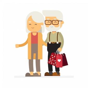 Compras da família feliz. pares velhos com sacos de compras, dia de valentim feliz.