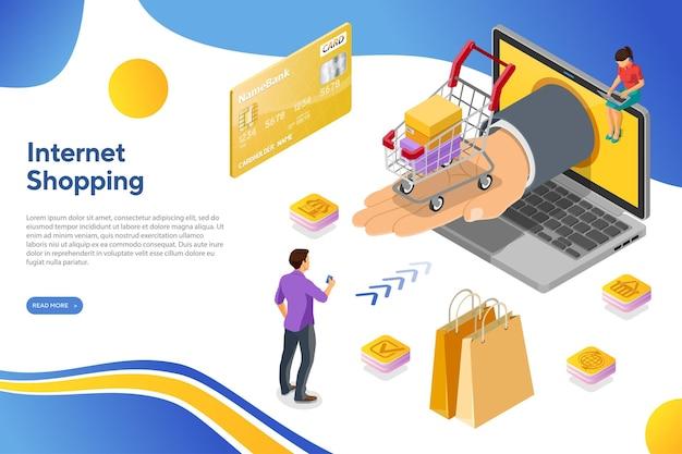 Compras online pela internet com laptop e mão com carrinho de compras