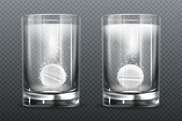Comprimido efervescente com bolhas de gás em copo de água