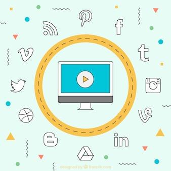 Computador com símbolos redes sociais