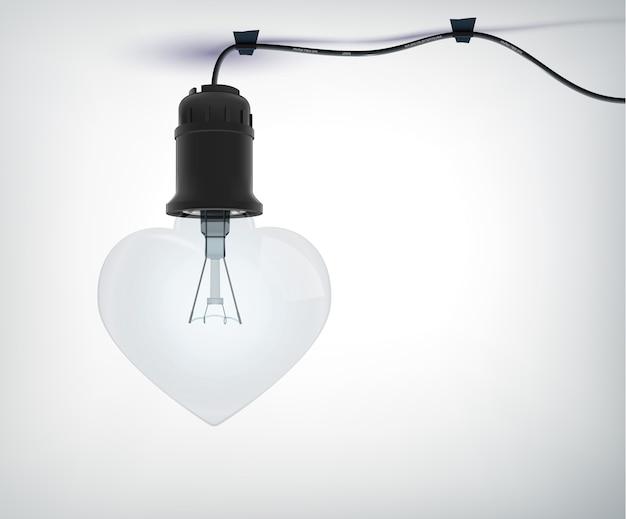 Conceito amoroso de lâmpada elétrica realista em forma de coração com cabo de alimentação em cinza isolado