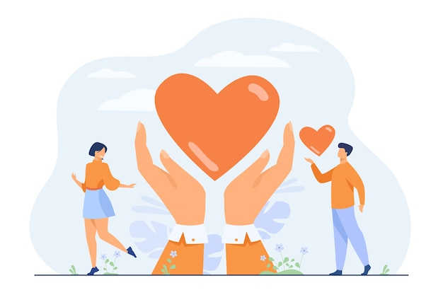 Conceito de caridade e doação. mãos de voluntários segurando e dando coração.