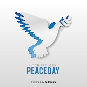 Conceito de dia de paz com pomba de papel