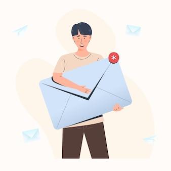 Conceito de envio e recebimento de mensagens de e-mail, homem segurando um grande envelope fechado