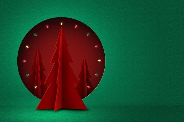 Conceito de feliz natal e feliz ano novo círculo vermelho decorado com árvore de natal e luz sobre fundo verde arte em papel
