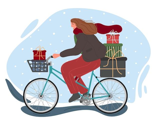 Conceito de férias de inverno de natal e feliz ano novo a menina anda de bicicleta com presentes