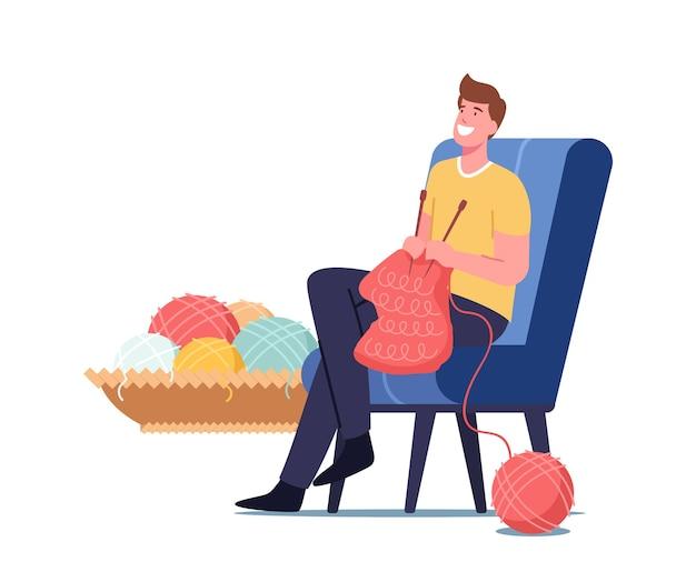 Conceito de hobby de artesanato. homem com agulhas de tricô tricotar roupas quentes de lã de cashmere para o inverno frio