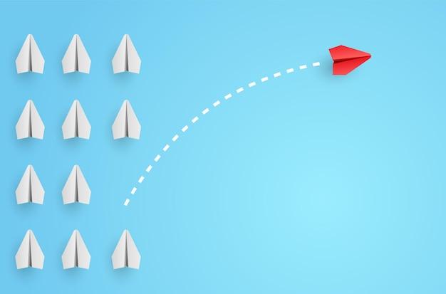 Conceito de individualidade. avião de papel vermelho líder individual e único voa para o lado.