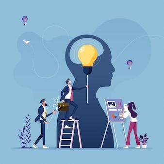 Conceito de inovação de negócios, trabalho em grupo de negócios para financiar o crescimento-lâmpada como uma metáfora da idéia