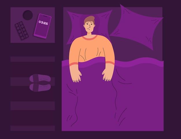 Conceito de insônia à noite, na cama, pessoa cansada não consegue dormir ao lado do dedo do pé celular comprimidos com água
