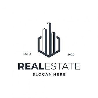 Conceito de logotipo imobiliário com elemento hexágono e cidade.