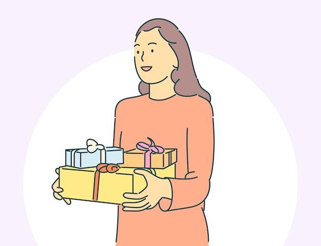 Conceito de natal ou ano novo. jovem feliz ou mulher mantém caixas de presentes em casa.