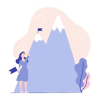 Conceito de negócio, realização do objetivo, sucesso, ganhando. mulher segurando bandeira e olhando para as montanhas. bandeira no pico da montanha.