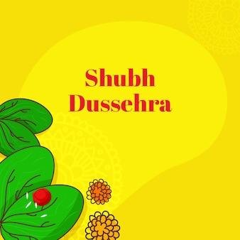 Conceito de shubh (feliz) dussehra com arroz roli sobre folhas e flores de apta sobre fundo amarelo.