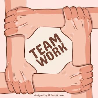 Conceito de trabalho em equipe com as mãos tocando os braços