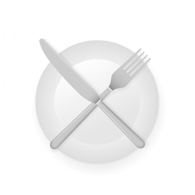 Conceito intermitente do jejum com faca e forquilha na exibição branca da placa, símbolo transversal.