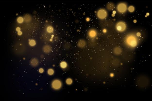 Conceito mágico de ouro. fundo preto abstrato com efeito bokeh.
