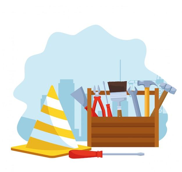Cone de tráfego e caixa com ferramentas de reparo