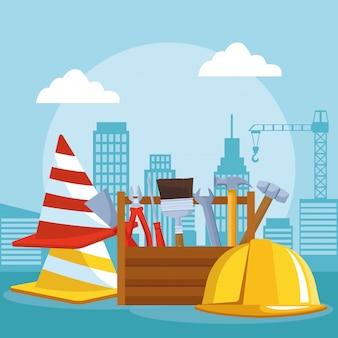 Cones de trânsito com caixa de ferramentas e capacete de segurança sob cenário de construção