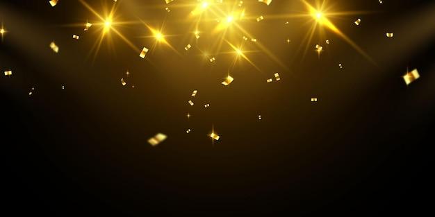 Confete dourado isolado no preto