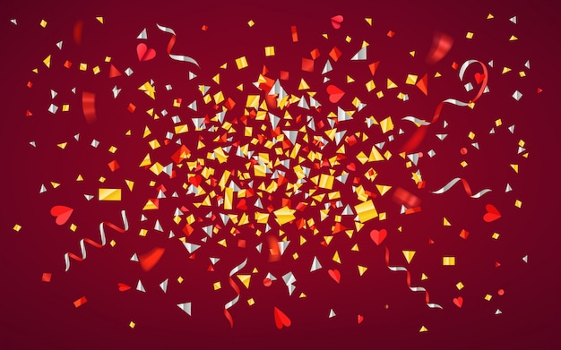 Confetes e fitas da folha da cor no fundo vermelho.