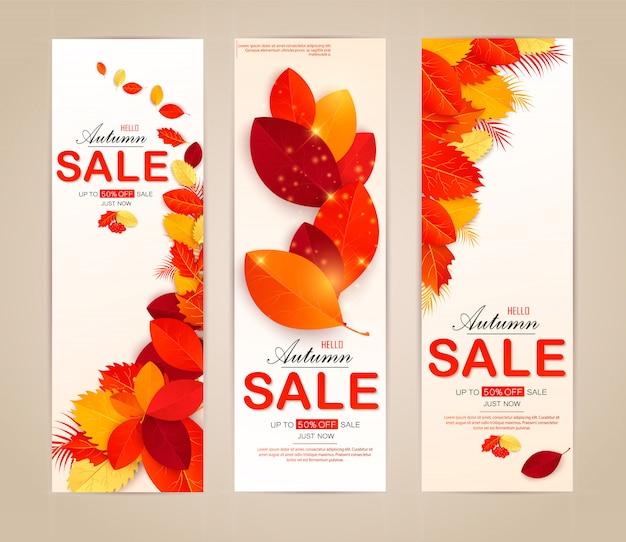 Conjunto banner com folhas de outono vermelhas, laranja, marrons e amarelas.