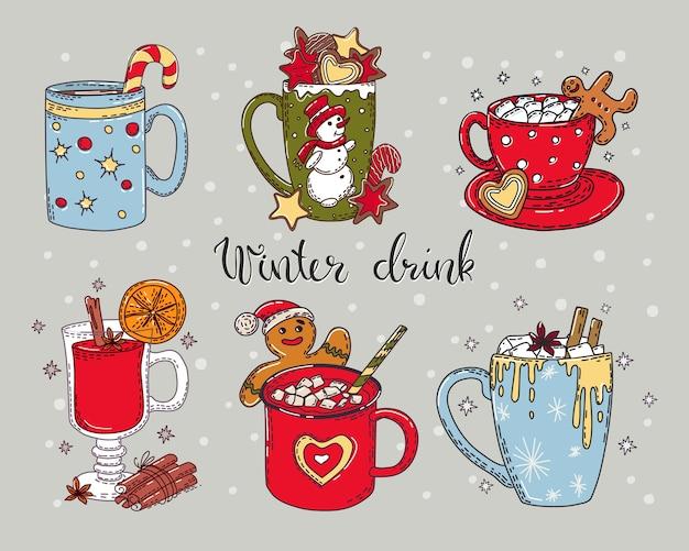 Conjunto colorido de bebidas quentes de inverno com caligrafia em um fundo isolado.
