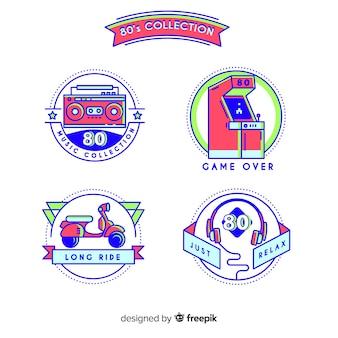 Conjunto colorido de emblemas dos anos 80