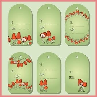 Conjunto com tags de presente de cogumelos vermelhos bonitos.