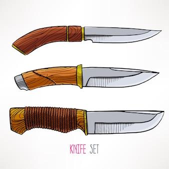 Conjunto com três facas de caça isoladas em branco