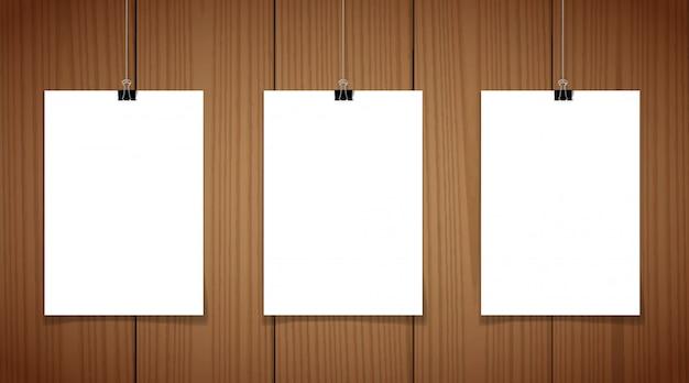 Conjunto de 3 cartazes em branco pendurado no fio com clipes