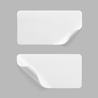 Conjunto de adesivos retangulares colados brancos com cantos enrolados