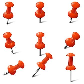 Conjunto de alfinetes realistas na cor vermelha. percevejos