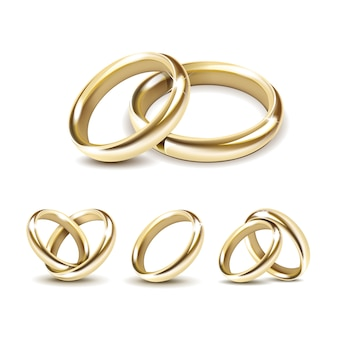 Conjunto de alianças de ouro isolado no branco