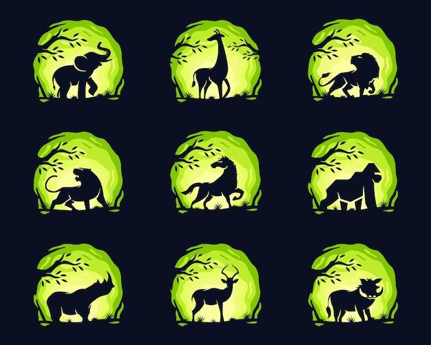 Conjunto de animais com árvore.
