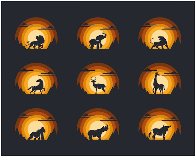 Conjunto de animais com montanha do penhasco e fundo do céu.